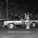Veteran racer Dick Schulze drove the Vandermeir No. 2 in 1965.  Schulze poses with assistant starter, Jack Minster.  (O'Hare Stadium Photo)