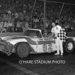 Gene Vandermeir and his No. 32 scored a heat race win at O'Hare on July 4, 1964.  He is joined by O'Hare's assistant starter, Jack Minster.  (O'Hare Stadium Photo)