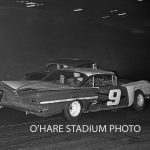 Jerry Vandermeir works the banked turns at O'Hare Stadium in his '59 Chevy No. 9 in 1962.  (O'Hare Stadium Photo)