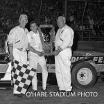 "Jim Vandermeir scored a late model feature race win at Chicagoland's O'Hare Stadium on June 6, 1964.  Joining him in the victory photo are starter Art Kelly (left) and O'Hare's Director of Competition, Frank ""Ham"" Lobaza.  (O'Hare Stadium Photo)"