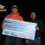 (left) Bohmer's Rt.66 Raceway promoter Robby Bohm presents race winner, Dustin Heath (right) his check for $512 for winning the Bohm Memorial race