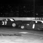 Teammates for awhile Ted Janecyk (#1) races with Johnny Kapovich (#37) at Raceway Park in 1964.  (Bud Norman Photo)