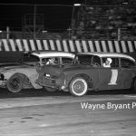 Ted Janecyk (#1) races inside of Bill Cornwall during late model racing at Raceway Park in 1962.  (Wayne Bryant Photo)