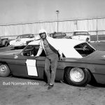 Ted Janecyk poses next to Bill Koenig's '62 Chevy No. 1 in the pits at Raceway Park in 1963.  (Bud Norman Photo)