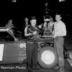 Ted Janecyk with track announcer Wayne Adams after his victory in the 100-lap Season Championship race at Raceway Park in 1963.  (Bud Norman Photo)