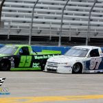 James Swan (#97) battles with Chester Ace (#93) for the lead in the closing laps of the Midwest Truck Series 20 lapper.