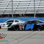 Griffin McGrath (#64) and Paul Shafer Jr. (#7) race down the main straightaway.