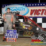 Jake Neuman in victory lane after winning the Badger midget feature race at Sycamore Speedway Saturday night.