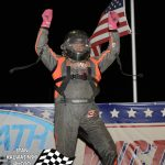 Jake Neuman celebrates his win in Badger midget competition.