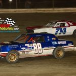 Mikey Huber II (#88) battles Mike Nelms (#714) during the pure stock division feature.