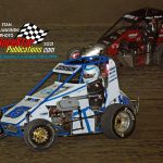 RJ Corson (#15) tries to stay ahead of Kyle Stark (#2) during the Badger midget feature.