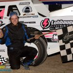 Zach Zuberbier poses in victory lane after winning the street stock 20 lapper.