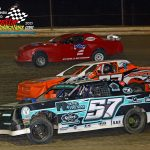 They go three-wide during the street stock feature race.