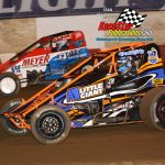 Ryan Marshall (#7) battles with Tim Cox (#40) during the sprint car feature.