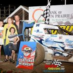 Sprint car feature winner Ryan Zielski with the Bryan Gapinski family including wife Jenna, daughter Kailey and son Tyler.
