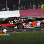 Wisconsin racer Jeff Holmgren (#5) races the inside the groove while Wes Griffith Jr. (#33) works the outside.