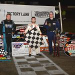Ty Majeski (center) stands in victory lane with third place finisher Ricky Baker (on the left) and runner-up DJ Weltmeyer (on the right) after winning the the 60th annual Tony Bettenhausen Memorial 100 late model stock car special at the Grundy County Speedway in Morris, Ill., on Saturday night.