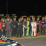 25 drivers pose for a photo before the 60th annual Tony Bettenhausen 100.