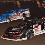 Shannon Babb (#18) and Brandon Sheppard (#1) battle during heat race action.