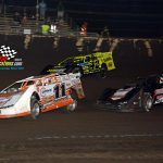 Trevor Gundaker (#11), Kevin Weaver (#B12) and McKay Wenger (#42) looking for racing room during a heat race.