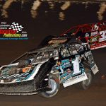 Ryan King (#1G) tries to stay ahead of Bobby Pierce (#32) during their heat race.