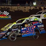 Mike McKinney (#96) works inside of Travis Kohler (#0) and Adam Pockrus (#48) during the modified main.
