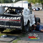 Dylan Woodling's modified gets some care in the pits prior to a night of racing.