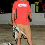 """Greg Kuntz has been handling the flagging duties at Grundy for a number of years.  """"Grundy Greg"""" started working at the speedway as the scoreboard operator."""