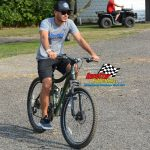 Before the night's racing began, Kyle Larson took a ride through the Fairbury pits on his bike.
