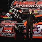 Sixteen-year-old Michael Ledford, from Pontiac, Ill., in victory lane after his modified win.