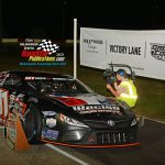 The Speed Sport TV affiliate Midwest Tour TV camera rolls as Ty Majeski's winning No. 91 sits in victory after the Wisconsin speedster won the 60th annual Tony Bettenhausen Memorial 100 late model stock car special.