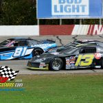 Three-wide for a moment, Brian Syer-Keske (#81) and Matthew Henderson (#33) pass the lapped car of Andrew Brocker (#13).