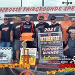 Casey Johnson and crew pose on the victory stage after Johnson won the ARCA Midwest Tour Oktoberfest 200 which closed out the 52nd annual Oktoberfest Race Weekend at the LaCrosse Fairgrounds Speedway in West Salem, Wis., Sunday afternoon.