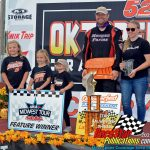 Race winner Casey Johnson is joined by his wife, Whitney, and his three daughters after winning the Oktoberfest 200.