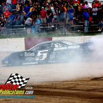 Casey Johnson does a burnout to celebrate his win.
