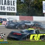 """The """"602"""" feature finds Clayton Storey (#69) spinning with a bunch of cars taking evasive moves including Ethan Rose (#48) who takes to the infield grass."""