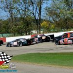 """The closing laps of the """"602"""" feature see eventual winner Bryce Miller in his No. 41 (outside of the back row) looking for racing room."""