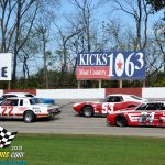 Vintage stock cars do battle during their 15-lap feature.